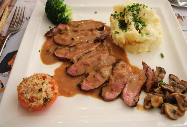 followed by slices of rare breast served in a mushroom pepper sauce