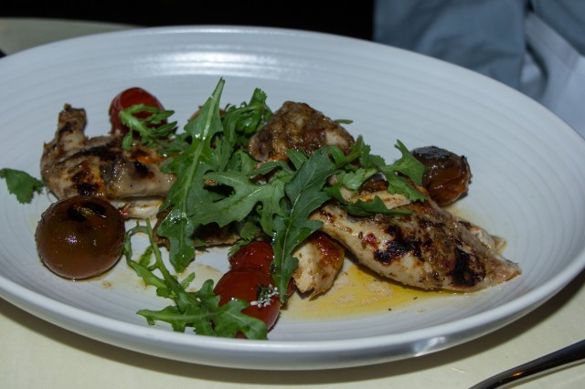 poussin served with roasted tomatoes