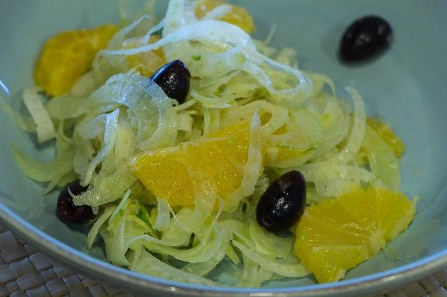 Fennel orange and black olive salad cooking in tongues for Mandolin mediterranean kitchen