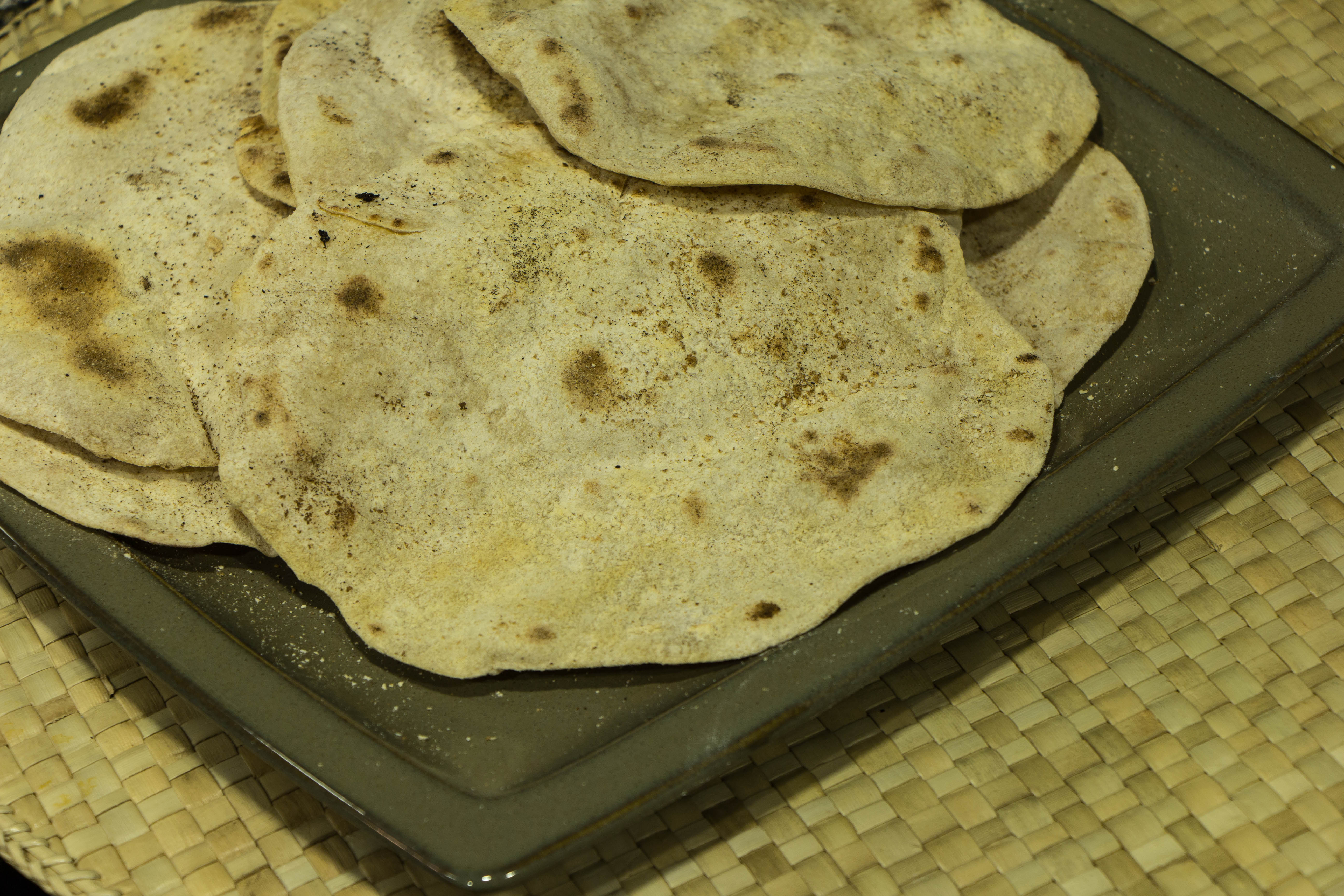Indian bread chapati cooking in tongues based on the recipe in classic indian cooking by julie sahni forumfinder Images