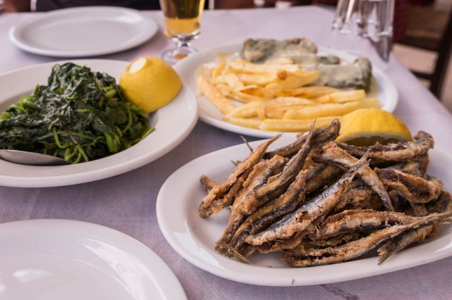 Karamalis - anchovies with dolmades and fries